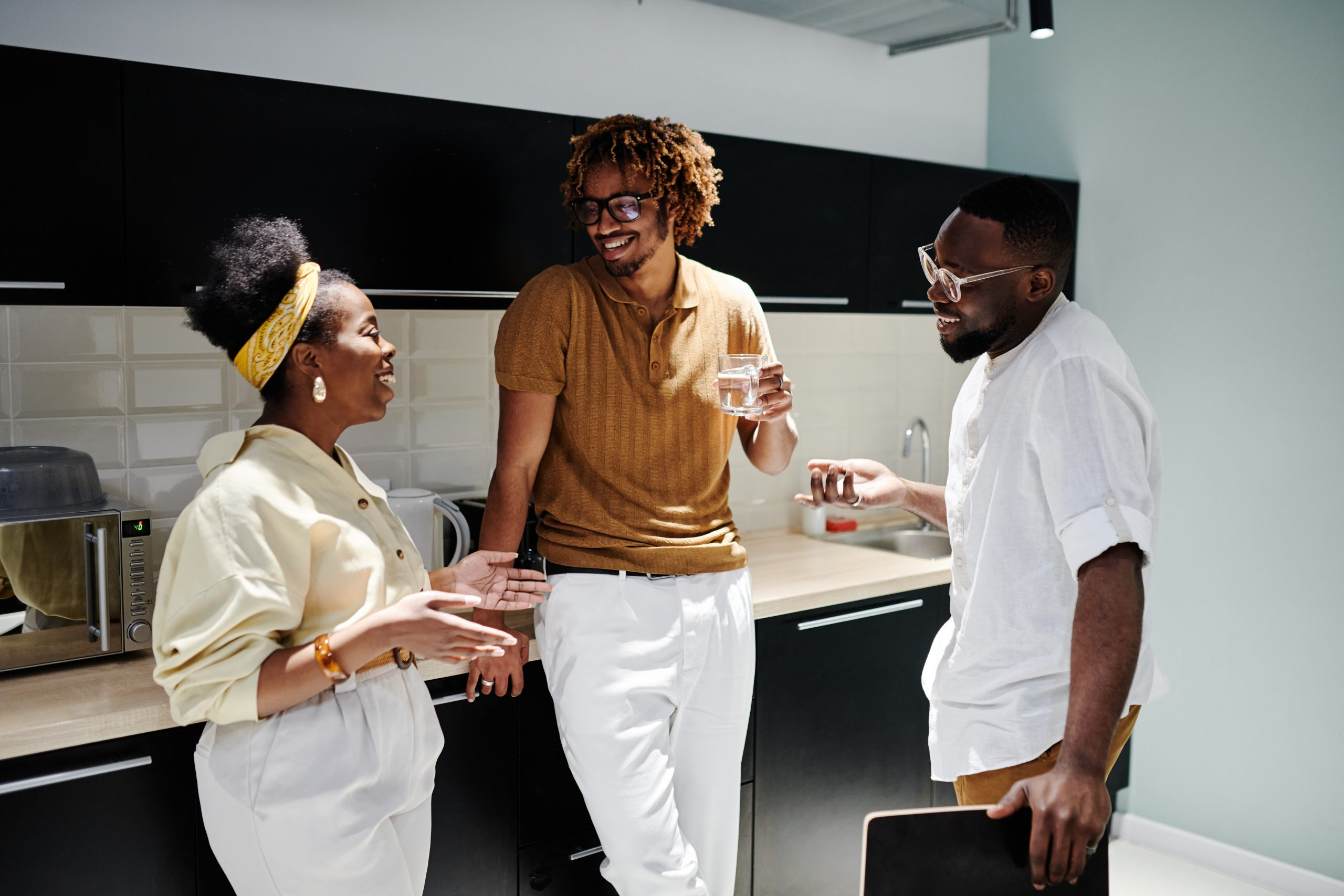 A group of people standing around and talking. This could depict a conversation shared between friends after a person seeks anxiety treatment in New York City. An anxiety therapist can help you start healing today. | 10018 | 11103 | 11211