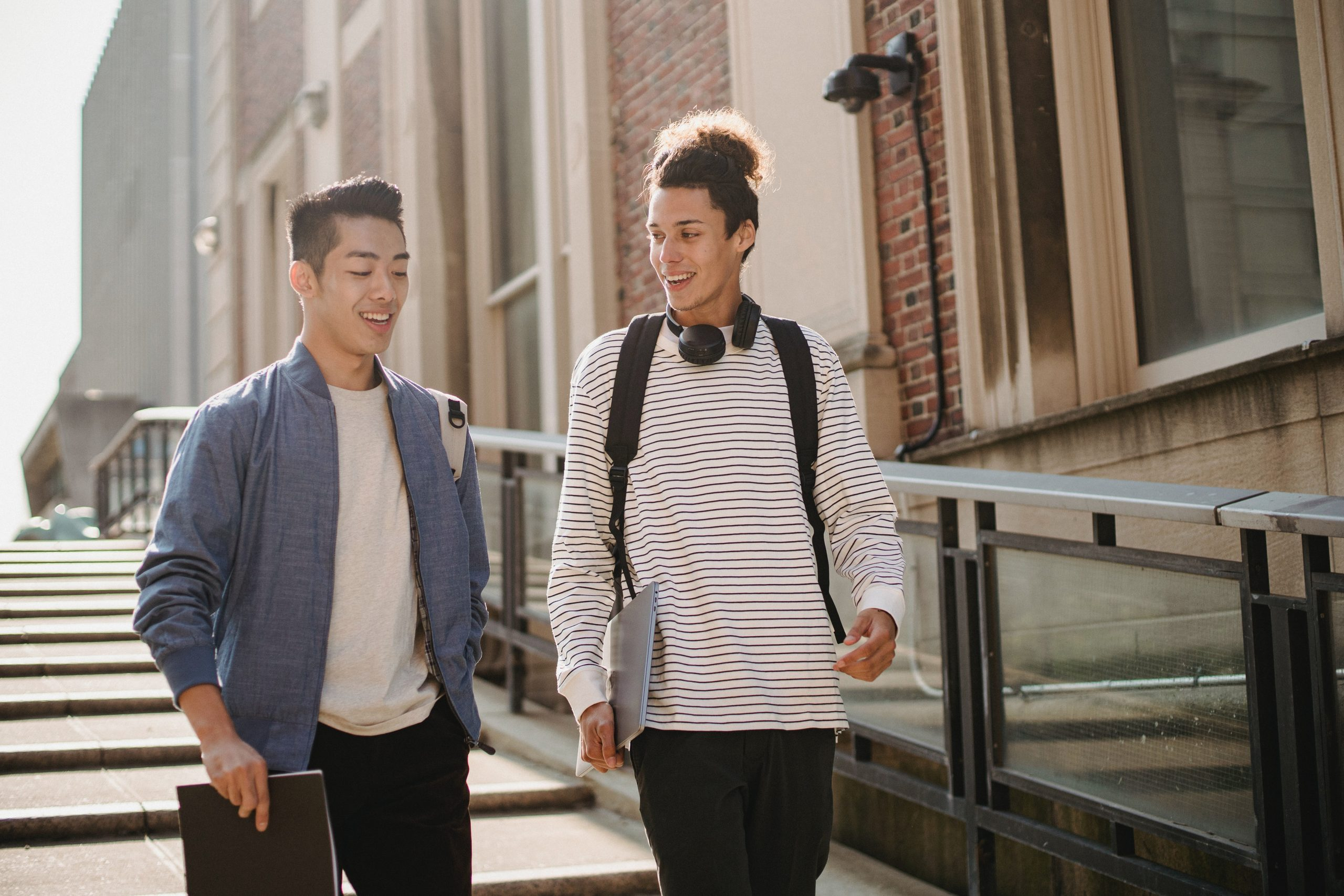 Image of two friends walking outside together. This image depicts how one may feel after meeting with a bipolar disorder therapist for bipolar disorder treatment in New York City. 10010 | 10011 | 10005