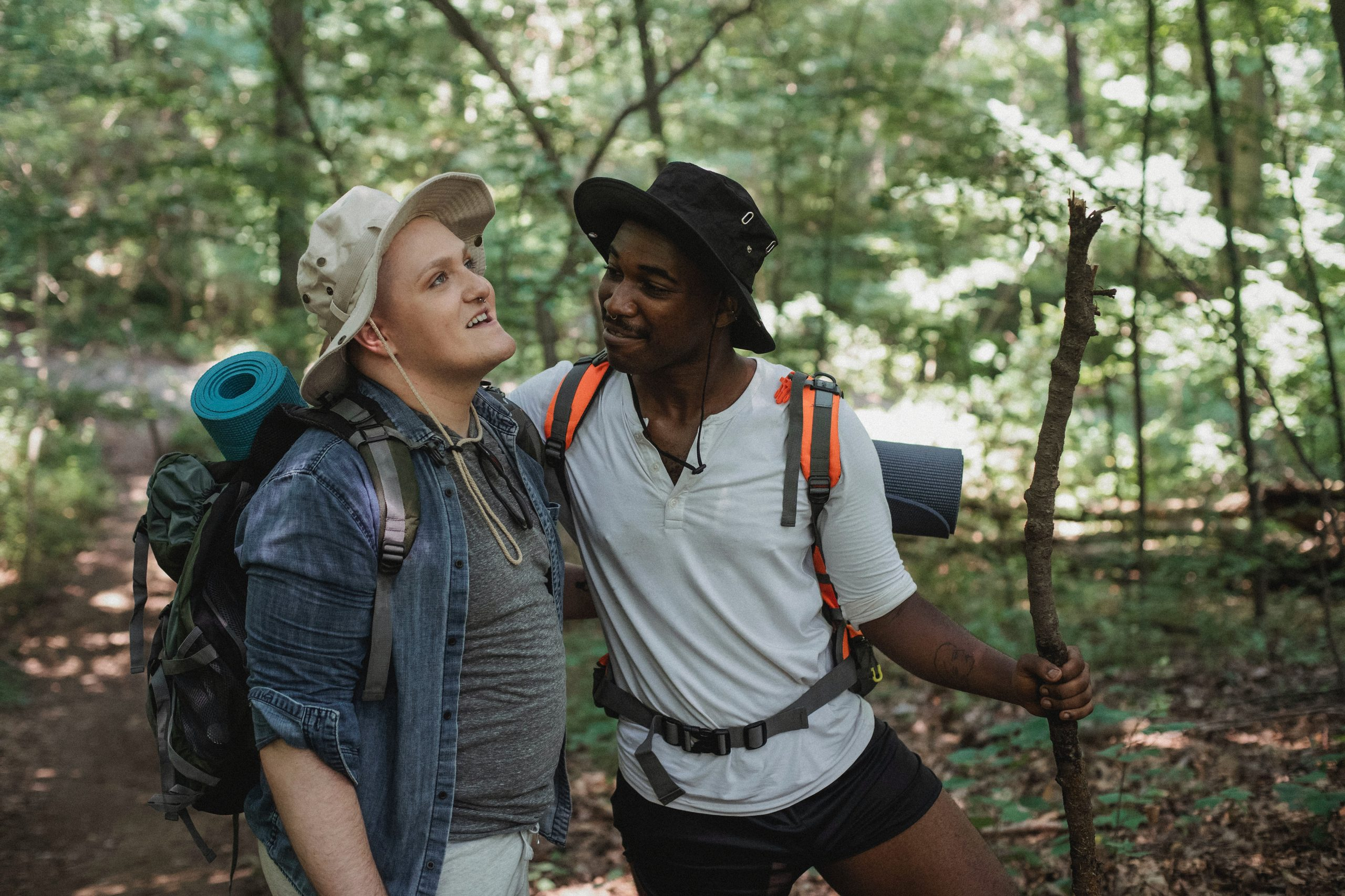 Image of two people hiking in the woods together. This image depicts how ADHD treatment in New York City can help individuals overcome adult ADHD symptoms. | 10010 | 10011 | 10005