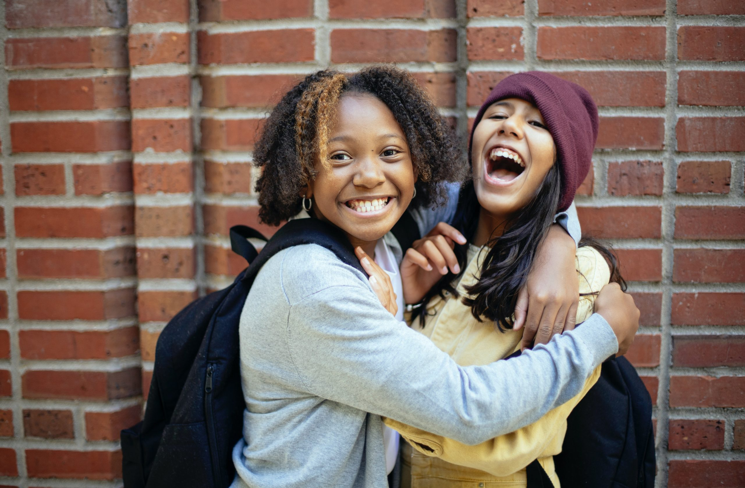 Image of two young people holding each other in a hug. This image illustrates how those in need of psychosis treatment in New York City may feel after treating their psychosis symptoms. | 10001 | 10002