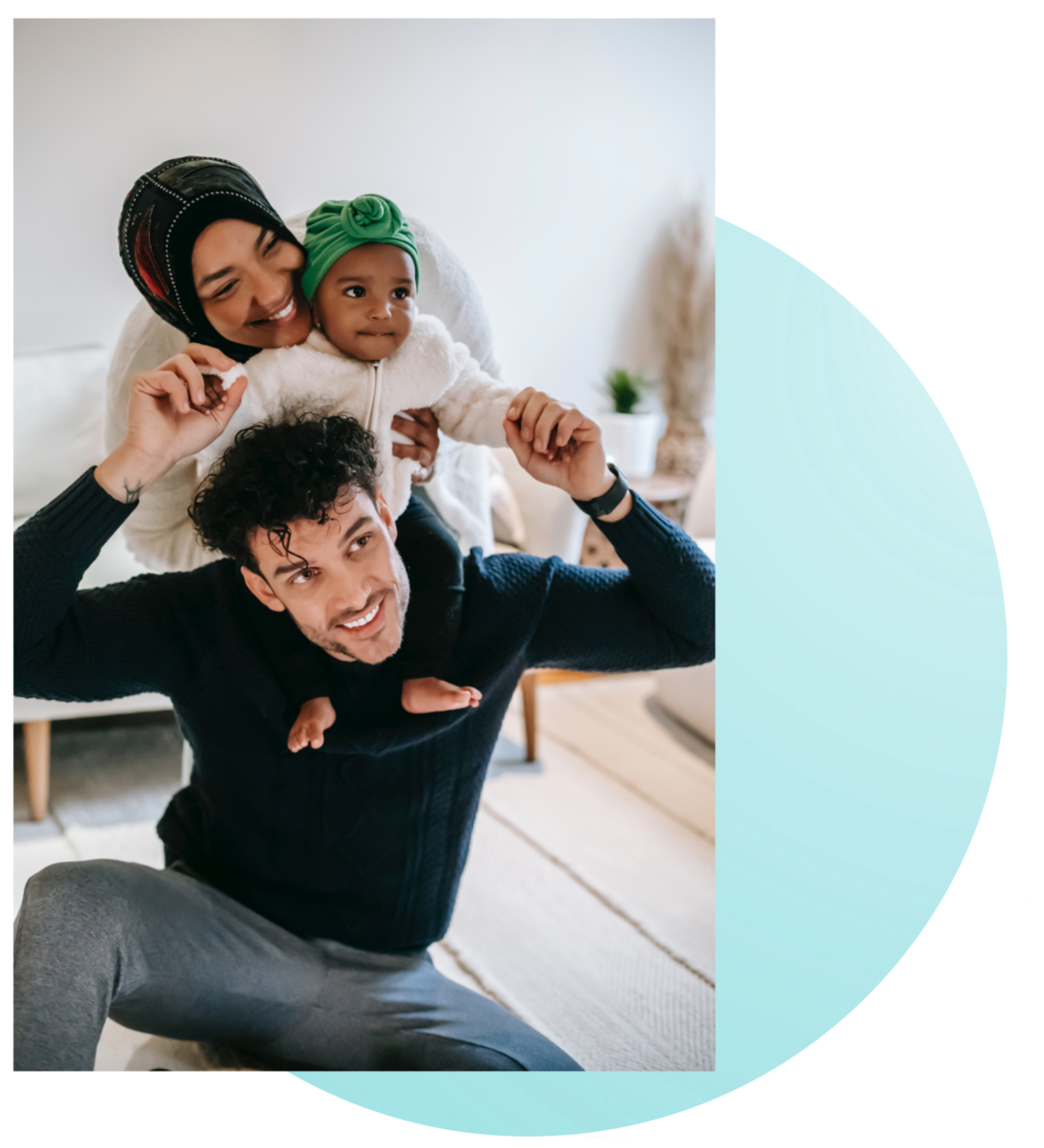 Image of two adults and a baby smiling together in a living room. This image depicts how meeting with a psychiatrist for psychiatric consultations in New York City can help you feel better.   10001   10002   11211